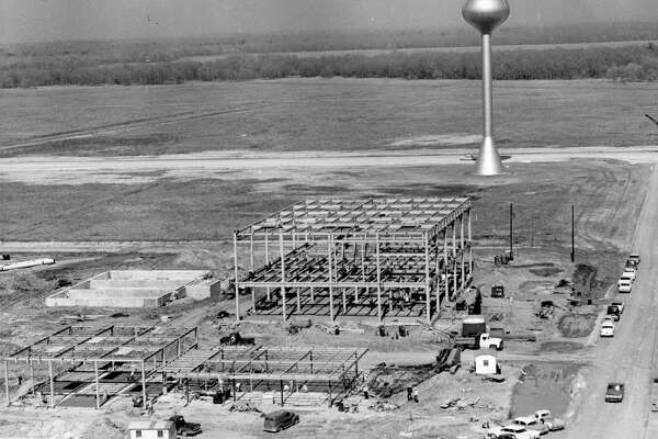 From the Houston Chronicle archives, February 1963: After months of expensive damage and site preparation work at the Clear Lake site of the Manned Spacecraft Center, the buildings are, at last, going up. The water tower marks the center of the site which is expected to have a daily working population of 10,000 persons by the end of 1965.