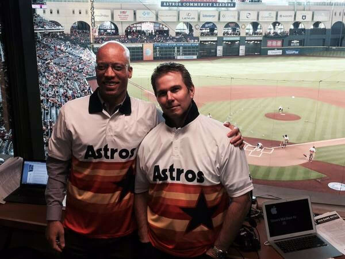 Astros radio broadcasters Robert Ford, left, and Steve Sparks have chronicled the franchise's rise from three straight 100-loss seasons to World Series champions.