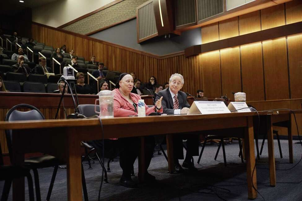 Amy Loprest, left, executive director of the New York City Campaign Finance Board and Frederick Schaffer, chair of the NYC Campaign Finance Board, testify at a Senate Standing Committee on Elections public hearing on campaign public financing at the the Legislative Office Building on Wednesday, March 20, 2019, in Albany, N.Y. (Paul Buckowski/Times Union)