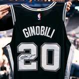 91394740ed5 Photo  Adrian Garcia Spurs Sports   Entertainment. Image 1 of   7. Caption.  Close. Image 1 of 7. Along with hosting the hot ticket Manu Ginobili jersey  ...