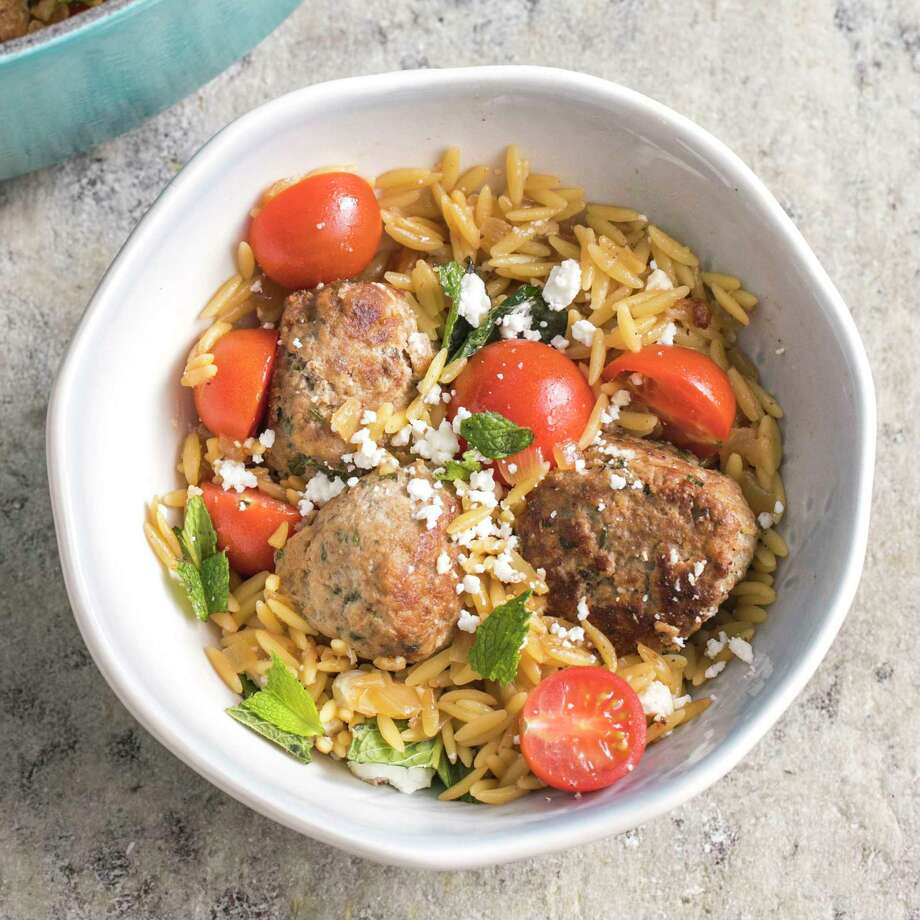 """This undated photo provided by America's Test Kitchen in March 2019 shows Lamb Meatballs With Orzo in Brookline, Mass. This recipe appears in the book """"Cook It In Your Dutch Oven."""" (Steve Klise/America's Test Kitchen via AP) Photo: Steve Klise / 2018, America's Test Kitchen, LLC. All Rights Reserved."""