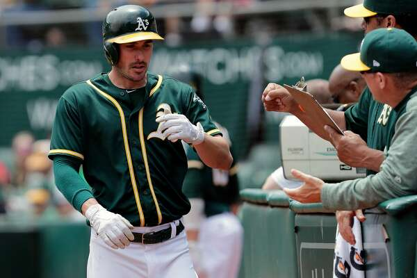 A's Matt Joyce is scored in the first inning on a Khris Davis ground out, as the Oakland Athletics take on the Chicago White Sox at the Oakland Coliseum on Wednesday July 5, 2017, in Oakland, Ca.