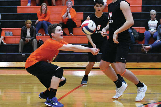 Edwardsville's Max Sellers successfully receives a serve during a home match last season inside Lucco-Jackson Gymnasium.