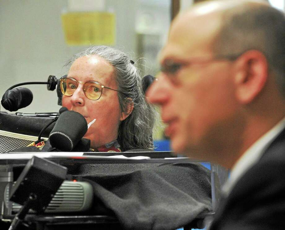In this file photo from Feb. 25, 2014, Cathy Ludlum of Manchester and of Second Thoughts Connecticut, and Peter Wolfgang of Waterbury, executive director of the Family Institute of Connecticut, speak with the New Haven Register about their opposition to a proposed aid-in-dying bill. Photo: Mara Lavitt / File Photo / Mara Lavitt