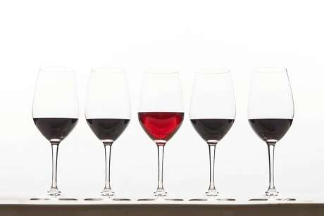 "A new trend in California wines is ""translucent reds"" which are lighter and brighter than traditional reds. Here a glass of translucent red is seen with darker traditional reds on Thursday, March 14, 2019 in San Francisco, Calif."