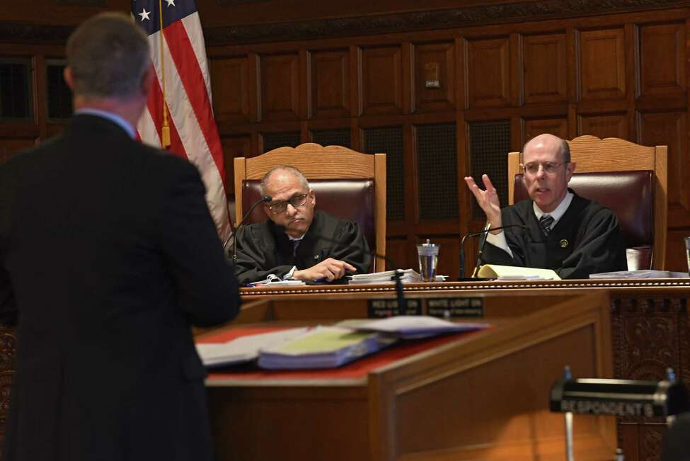 Attorney Scott Braum, left, representing Ohio gun dealer Charles Brown, listens to a question from Hon. Eugene Fahey, right, during the Williams v Beemiller, Inc. case at the New York Court of Appeals on Wednesday, March 20, 2019 in Albany, N.Y. (Lori Van Buren/Times Union)