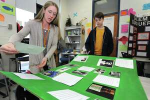 Laura Czegledi works with her Gifted and Talented students including 7th grader Vincent Mola on his National History Day project, Radium Girls: Precision Painting Turned Tragic, Wednesday, March 20, 2019, at Roton in Norwalk, Conn. National History Day is program for students in grades 6-through-12 that encourages exploration of local, state, national and world history. Students from across the district are gearing up to participate in the National History Day Regional Competition in Fairfield on April 6. Students conducted research on a historical topic and created a final project to demonstrate their work.