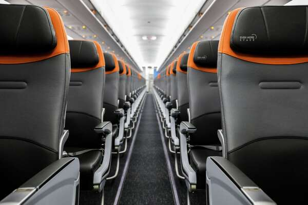 JetBlue is updating its Airbus A320 fleet with new black, gray and orange accented seats and better technology.