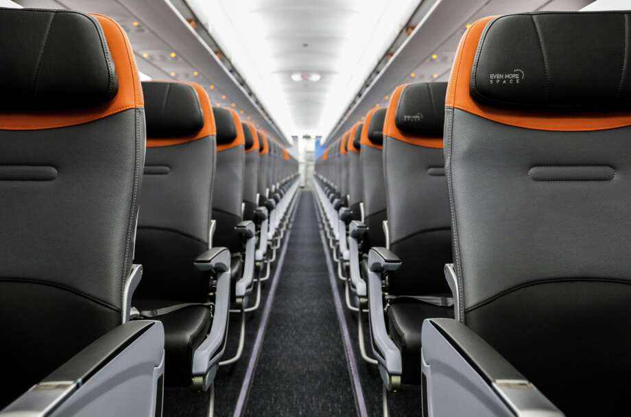 JetBlue is updating its Airbus A320 fleet with new black, gray and orange accented seats and better technology. Photo: JetBlue