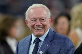 FILE - In this Oct. 7, 2018, file photo, Dallas Cowboys owner Jerry Jones smiles before the team's NFL football game against the Houston Texans in Houston. If Jones were to run for president, he'd have to run on his record, and in the NFL it hasn't been great in recent years for Jones, whose Cowboys have won only three playoff games in the last 20 years. Still, imagine the parties in the Rose Garden should he be elected. (AP Photo/David J. Phillip, File)