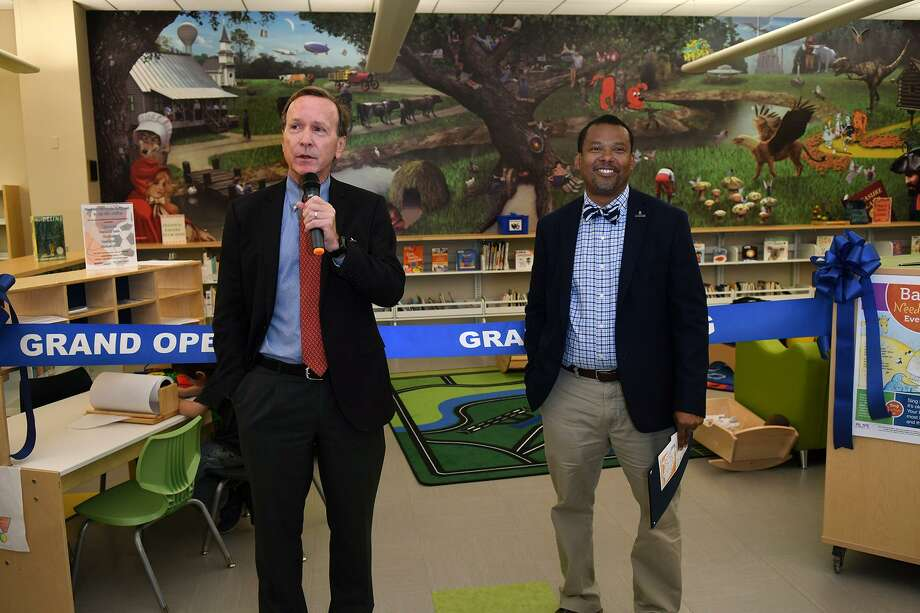 Neil Bush, left, the son of President George H.W. and Barbara Bush, makes his remarks beside Harris County Public Libraries director Edward Melton during the ribbon cutting ceremony for the Barbara Bush Library Family Place on March 19, 2019. Photo: Jerry Baker, Houston Chronicle / Contributor / Houston Chronicle