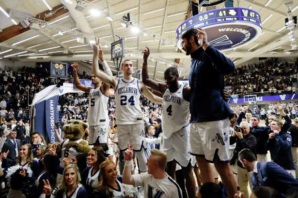 Villanova's Phil Booth, Joe Cremo, Eric Paschall and Tim Delaney, from left, celebrate after an NCAA college basketball game against Marquette, Wednesday, Feb. 27, 2019, in Villanova, Pa. Villanova won 67-61. (AP Photo/Matt Slocum)