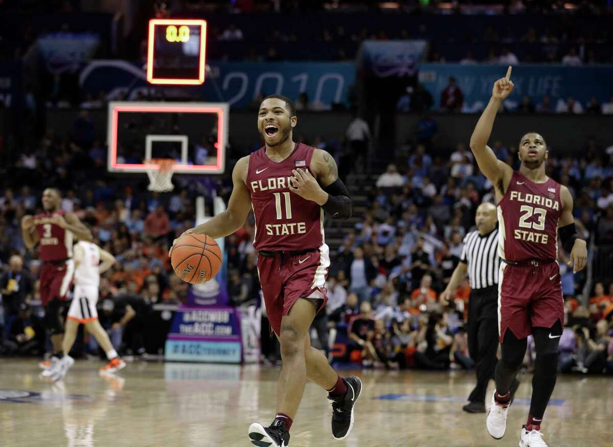 Florida State's David Nichols (11) and M.J. Walker (23) react after their team defeated Virginia in an NCAA college basketball game in the Atlantic Coast Conference tournament in Charlotte, N.C., Friday, March 15, 2019. (AP Photo/Chuck Burton)