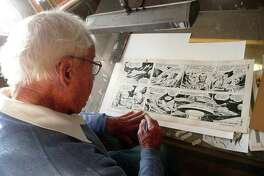 Greenwich resident Bob Fujitani points out a Flash Gordon strip he illustrated. âÄúImagination was a must in (the cartooning) business,âÄù he says. âÄúI was just making this stuff up.âÄù