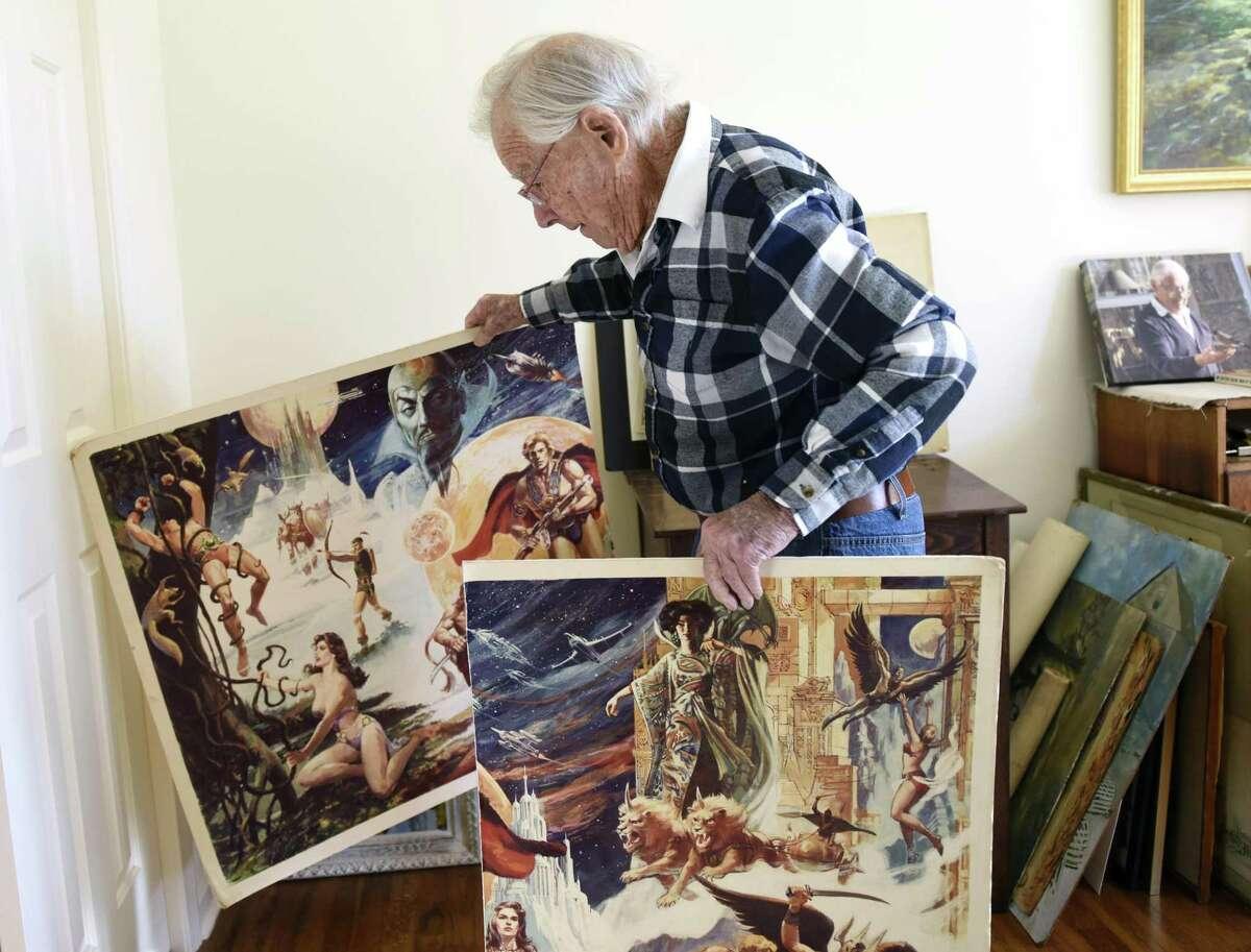 Comic artist Bob Fujitani, 97, shows a poster he drew for