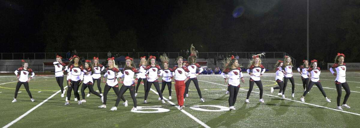 The Cardinal Cheer team performs at half-time at the Greenwich High School Homecoming game against Fairfield Ludlowe in Cardinal Stadium on Thursday, Oct. 24, 2018 in Greenwich, Connecticut.