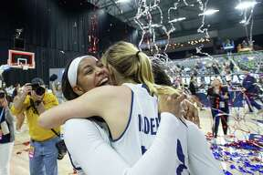 Rice guard Shani Rainey, left, celebrates with The Woodlands High School alumna Nicole Iademarco after defeating Middle Tennessee 69-54 in an NCAA college basketball game in the championship game of the Conference USA women's tournament this past Saturday.