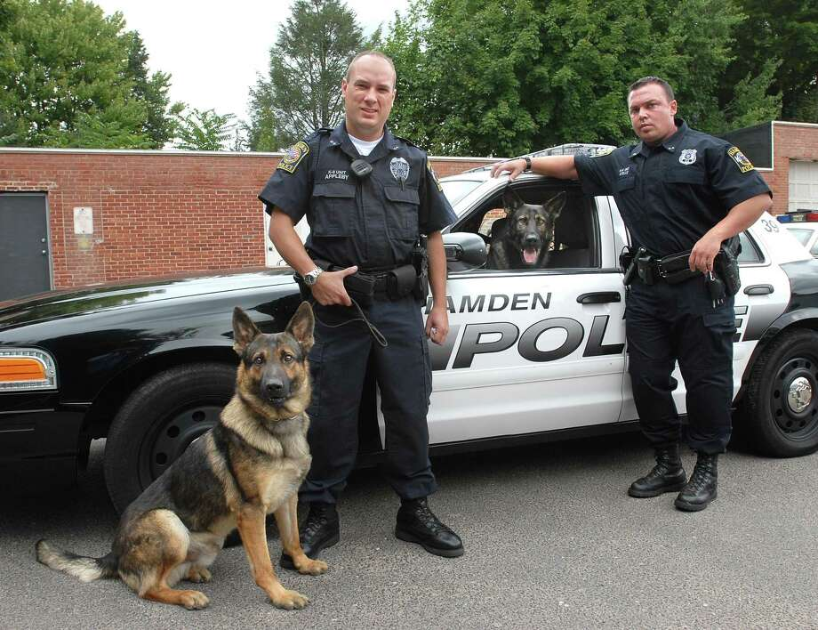 "Hamden K-9 Police Officers Craig Appleby, left, with ""Hunter"" and Bryan Kelly with ""Brix"" in this file photo. Photo: Peter Casolino / File Photo"