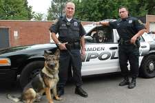 """Hamden K-9 Police Officers Craig Appleby, left, with """"Hunter"""" and Bryan Kelly with """"Brix"""" in this file photo."""
