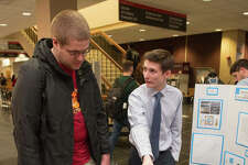 Jack White, an electrical engineering master's candidate from O'Fallon, Ill., discussed his research project with fellow student Steven Slaby, of Edwardsville, during the SIUE Graduate School Spring Symposium.
