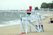 A lifeguard is on duty at Seaside Park in Bridgeport, Conn., on Friday, Aug. 3, 2018. Rising prices to visit the beach in Westport is causing people to find lower priced beaches and parks to visit.