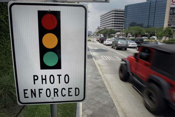 Houston removed its red-light cameras, including this one seen in July 2011 at Loop 610 and Westheimer, after voters rejected their use.