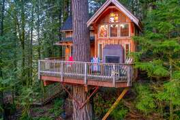 This estate in east King County includes a 7,640-square-foot home full of amenities as well as a 10-acre plot and, if one home isn't enough, another treehouse that sleeps four. The home is listed for $2.85 million.