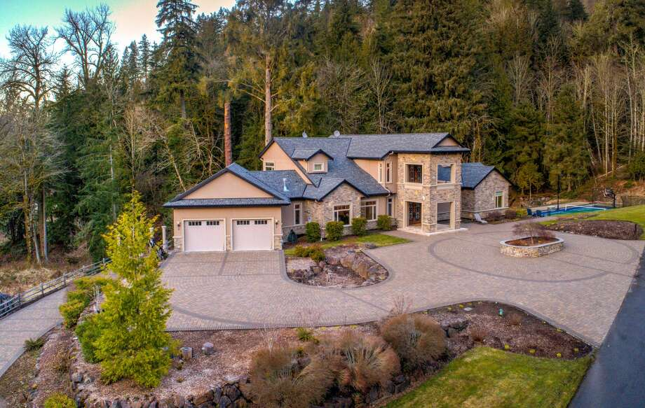 This estate in east King County includes a 7,640-square-foot home full of amenities as well as a 10-acre plot and, if one home isn't enough, another treehouse that sleeps four. The home is listed for $2.85 million. Photo: Photo By Brandon Heiser/courtesy Windermere