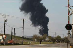 A plume of black smoke rises from the ITC industrial site on March 20, 2019, after an apparent flare-up.