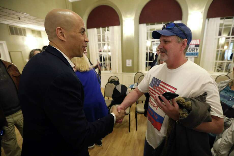 Democratic presidential hopeful Sen. Cory Booker, meeting residents in Iowa, has a realistic view — that the current political fanaticism is not the normal human state. Photo: Charlie Neibergall / Associated Press / Copyright 2019 The Associated Press. All rights reserved