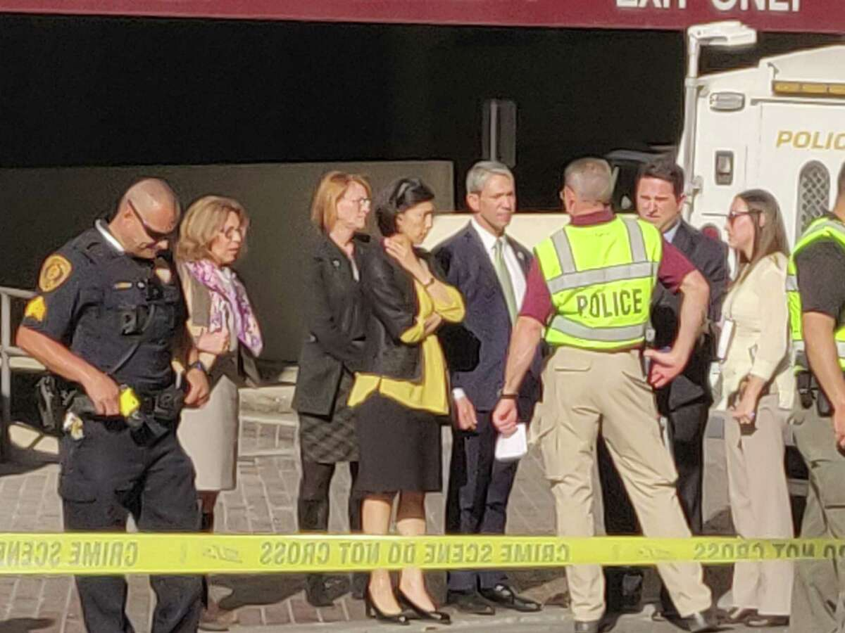 City officials gather at the scene of an accident in which a pedestrian was killed by a vehicle at about 4:30 p.m. Wednesday in the 100 block of St. Mary's Street.