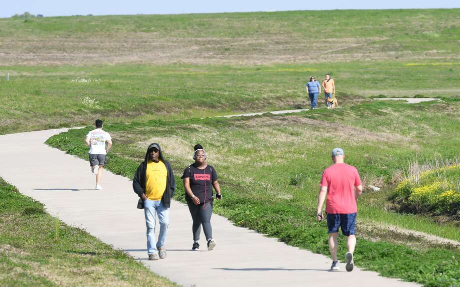 Health enthusiasts walk the Folsom Hike and Bike Trail in Beaumont on Tuesday.  Photo taken Tuesday, 3/19/19 Photo: Guiseppe Barranco/The Enterprise, Photo Editor / Guiseppe Barranco ©