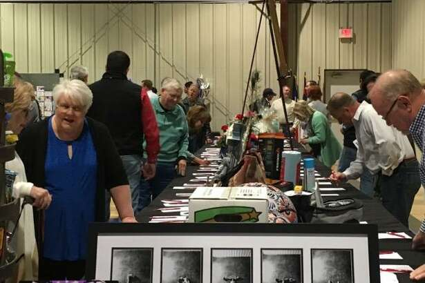 Auction participants browse products items during last year's event.