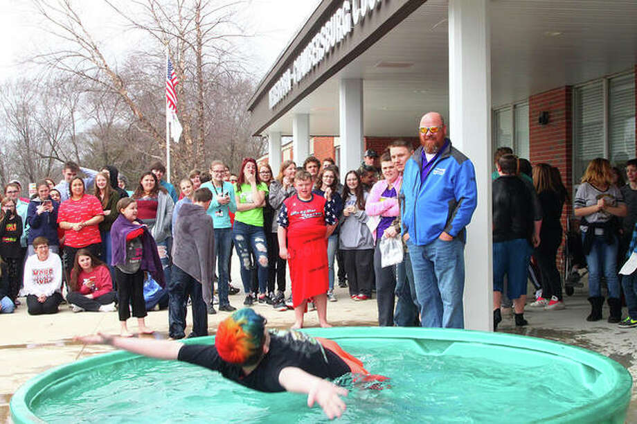 Meredosia-Chambersburg schools students and staff donated $10 to participate Wednesday in an ice-water challenge in the district. The event was organized by the student council and the Law Enforcement Torch Run to benefit Special Olympics. Photo: Rosalind Essig   Journal-Courier