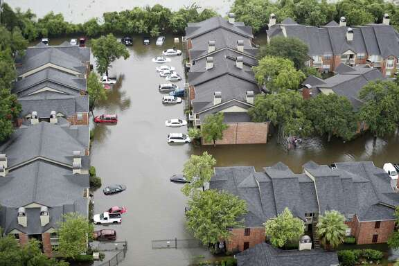 Floodwaters surround an apartment complex as floodwaters rise from Tropical Storm Harvey on Tuesday, Aug. 29, 2017, in Houston.