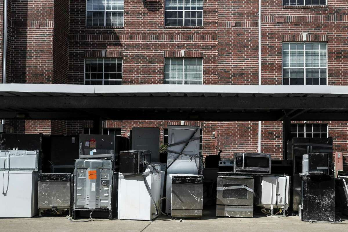 Appliances sit outside buildings at The Grand on Memorial which flooded during Hurricane Harvey Wednesday, Oct. 4, 2017 in Houston.