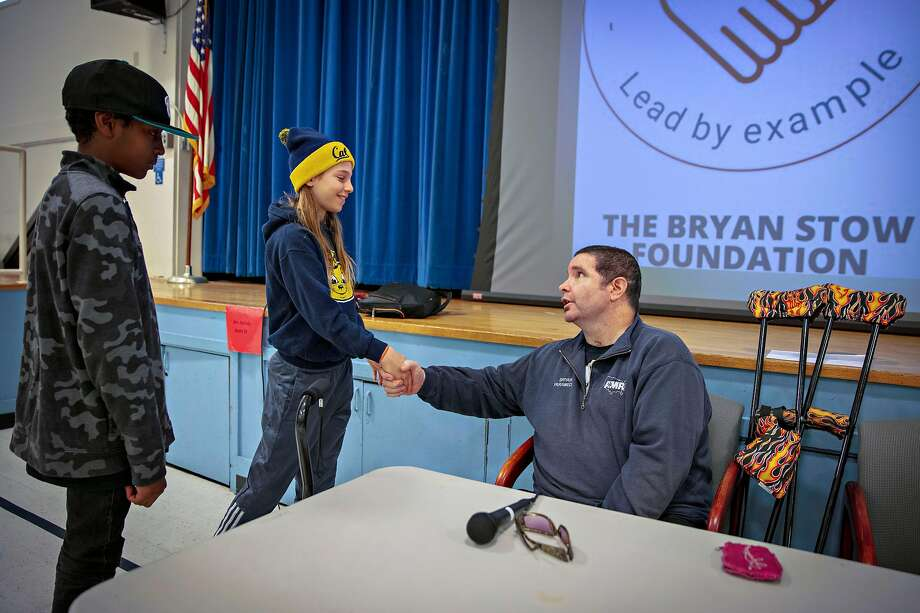5th grade students Zoe Cohen, 11 and Charles Booker meet and chat with Bryan Stow after delivering his anti-bullying speech at the Mary Farmar Elementary School in Benicia, California, USA 1 Mar 2019. Stow is the Giants? fan who suffered a severe brain injury during assault after Opening Day game at Dodger Stadium in 2011. (Peter DaSilva/Special to The Chronicle) Photo: Peter DaSilva / Special To The Chronicle
