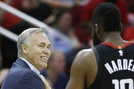 Houston Rockets head coach Mike D'Antoni looks back at James Harden (13) during a break in the action in the second half of an NBA basketball game against the Philadelphia 76ers at Toyota Center on Friday, March 8, 2019, in Houston.