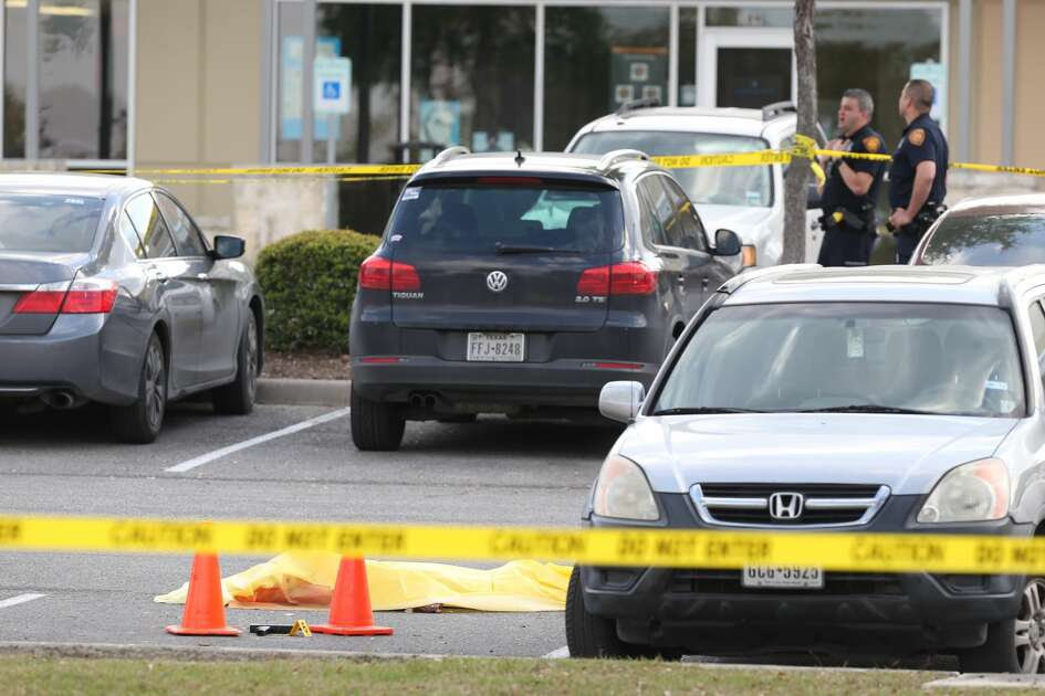 San Antonio Police investigate the scene of an officer involved shooting at the Huebner Commons shopping center at the corner of Huebner and Vance Jackson, Wednesday, March 20, 2019. According to SAPD Chief William McManus, a 23-year-old woman was acting erratically and was seen to be carrying a weapon, a police sargent responded and the woman pulled out an Uzi and was shot dead.