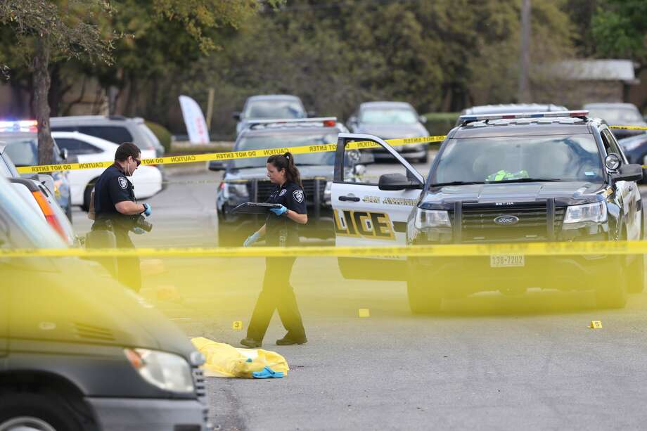 San Antonio Police investigate the scene of an officer involved shooting at the Huebner Commons shopping center at the corner of Huebner and Vance Jackson, Wednesday, March 20, 2019. According to SAPD Chief William McManus, a 23-year-old woman was acting erratically and was seen to be carrying a weapon, a police sargent responded and the woman pulled out an Uzi and was shot dead. Photo: Jerry Lara