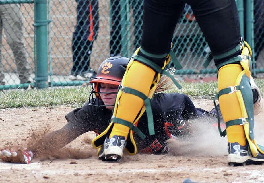 Edwardsville's Lexi Gorniak slides safely across home plate in the third inning against Southwestern on Wednesday inside the District 7 Sports Complex. Photo: Matt Kamp/The Intelligencer