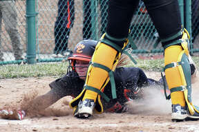 Edwardsville's Lexi Gorniak slides safely across home plate in the third inning against Southwestern on Wednesday inside the District 7 Sports Complex.