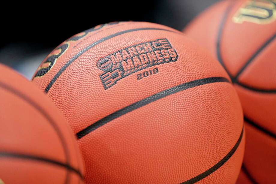 A basketball with March Madness 2019 sits in a rack before Michigan practice at the NCAA college basketball tournament in Des Moines, Iowa, Wednesday, March 20, 2019. (AP Photo/Nati Harnik) Photo: Nati Harnik / Copyright 2019 The Associated Press. All rights reserved