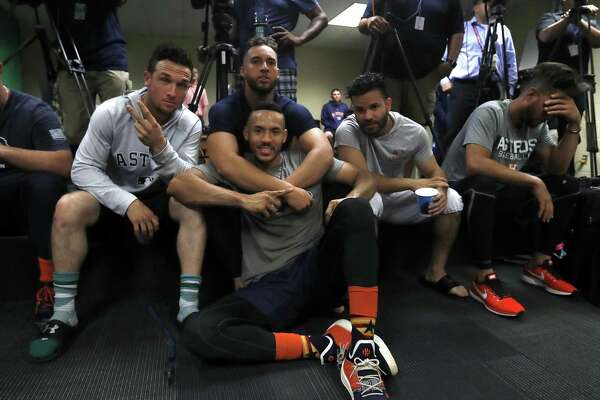 Of what is considered the Astros' core four, Alex Bregman, left, and Jose Altuve, right, have landed nine-figure extensions while George Springer, top, and Carlos Correa await their jackpots.