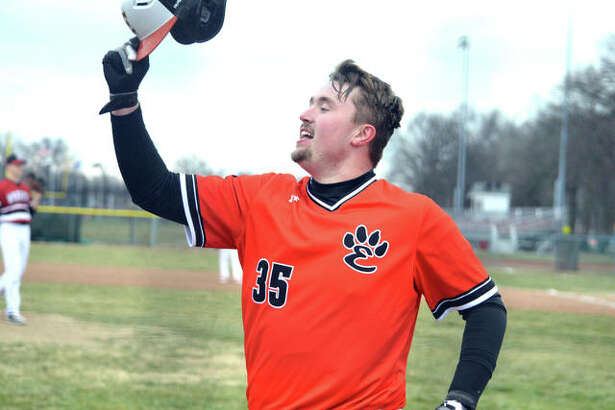 Edwardsville junior Jacob Kitchen celebrates after hitting a solo home run in the top of the seventh inning in Wednesday's game at Granite City.
