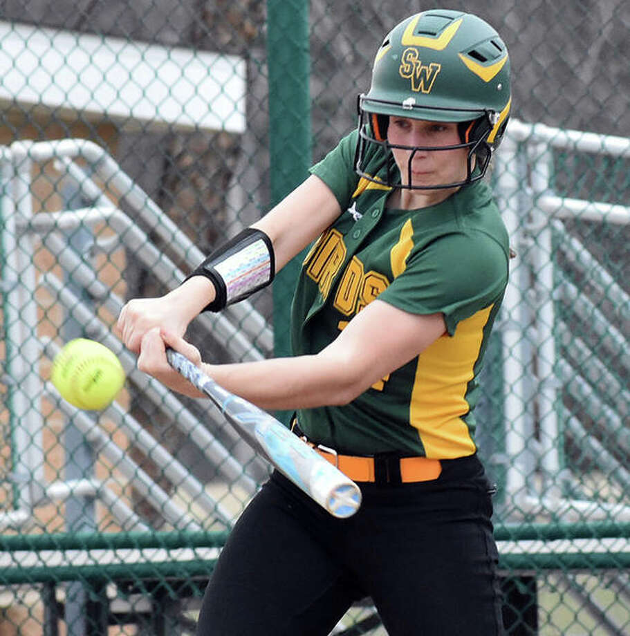 Southwestern's Megan Bailey connects for a RBI double in the first inning against the Edwardsville Tigers on Wednesday at the District 7 Sports Complex in Edwardsville. It was the first hits in the win for Bailey. Photo: Matt Kamp / Hearst Illinois