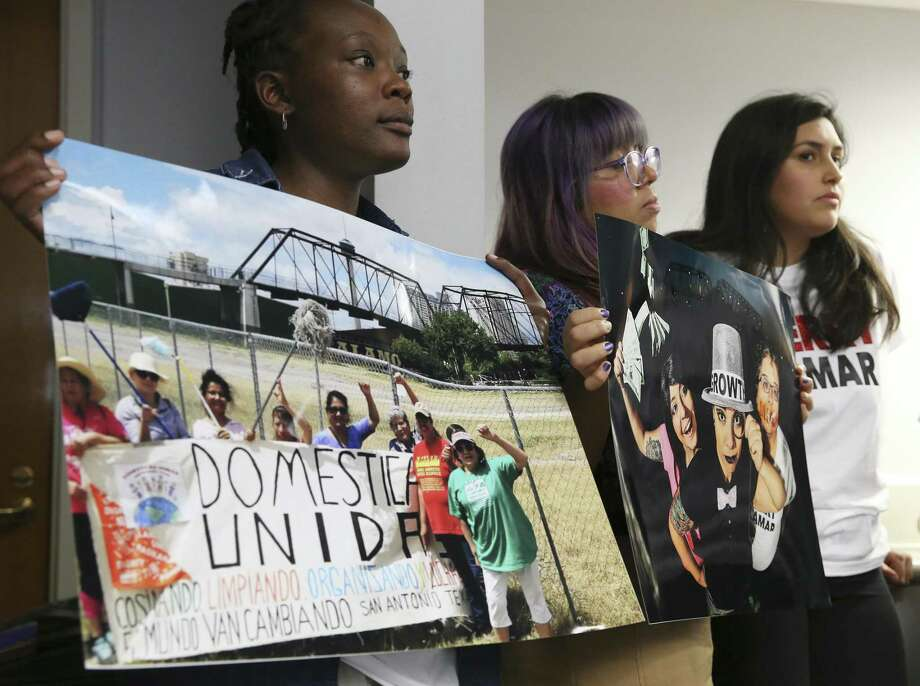 From left, Imgard Rop and Eliza Perez hold photographs of the Hays Street Bridge in protest during a City of San Antonio Council B-Session March 20. A development near the bridge is an issue in District 2. The Editorial Board recommends Jada Andrews-Sullivan in that race. Photo: Jerry Lara /Staff Photographer / © 2019 San Antonio Express-News