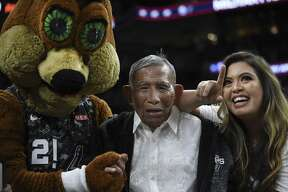 Liban Brillantes, 103, who was born in the Philippines and served in the Army's 121st Infantry Division, is accompanied by the Spurs Coyote and his granddaughter, Precious Joy Ross, during a timeout of the Miami Heat at San Antonio Spurs NBA game in the AT&T Center on Wednesday, March 20, 2019. Brillantes was only 19 when he served as a messenger between the U.S. and Philippine governments during World War II. He witnessed an execution of prisoners by Japanese soldiers and found one prisoner alive. He carried him into the jungle and nursed him back to health.
