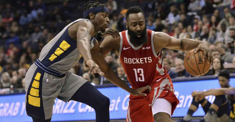 Houston Rockets guard James Harden (13) is defended by Memphis Grizzlies forward Justin Holiday during the second half of an NBA basketball game Wednesday, March 20, 2019, in Memphis, Tenn. (AP Photo/Brandon Dill) Photo: Brandon Dill/Associated Press