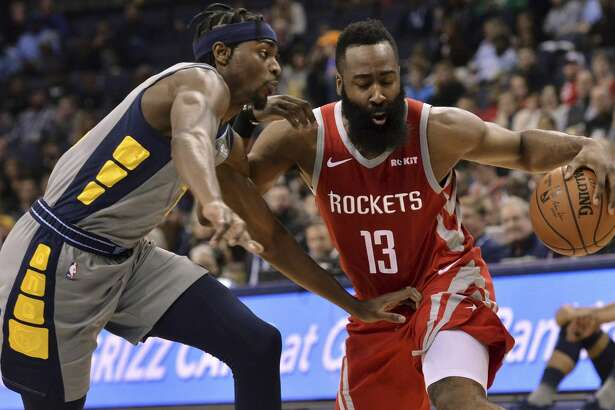 Houston Rockets guard James Harden (13) is defended by Memphis Grizzlies forward Justin Holiday during the second half of an NBA basketball game Wednesday, March 20, 2019, in Memphis, Tenn. (AP Photo/Brandon Dill)